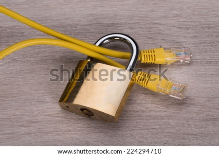 Network cable in padlock. Secure internet connection concept - stock photo