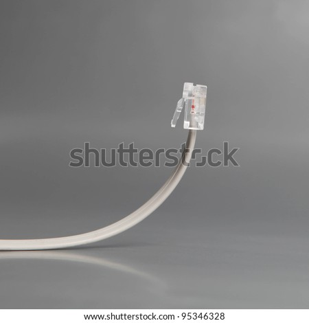 Network cable isolated on grey background - stock photo