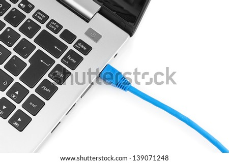 Network cable to connect the network to the laptop. View from above. - stock photo