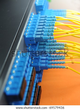 network cables and servers in a technology data center - stock photo