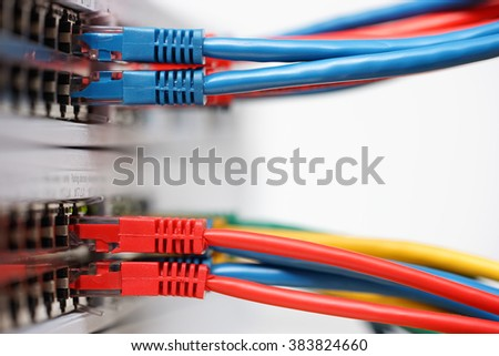 network cables connected in network switches with copy space - stock photo