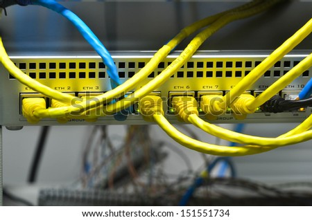 network cables connected to switch - stock photo