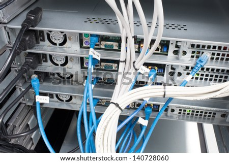 Network cables in a data center - stock photo