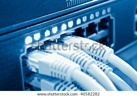 network cables in hub with shallow depth of field