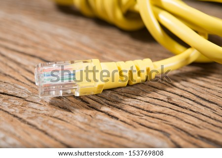 network cables on wood background - stock photo