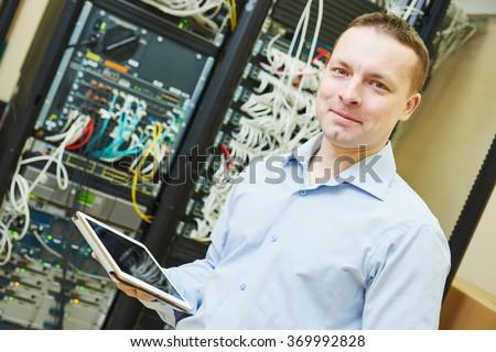 network engineer admin at data center - stock photo