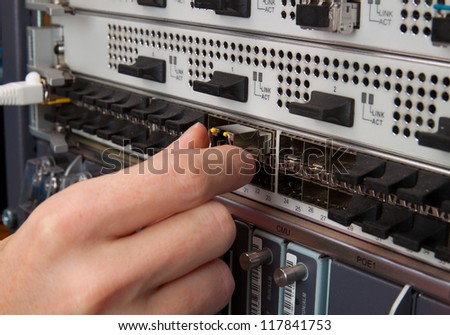 Network engineer insert transceiver