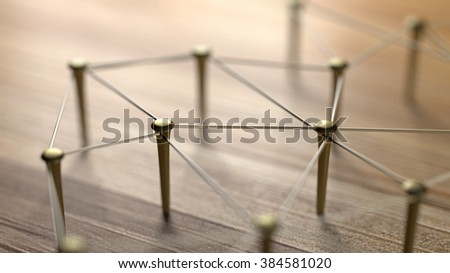 Network, networking, connect, wire. Linking entities. Network of gold wires on rustic wood.