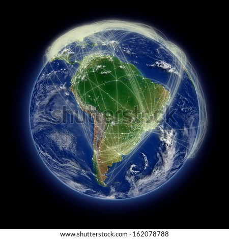 Network of flight paths over South America on blue planet Earth isolated on black background. Highly detailed planet surface. Elements of this image furnished by NASA.