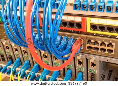 Network panel, switch and cable in data center - stock photo
