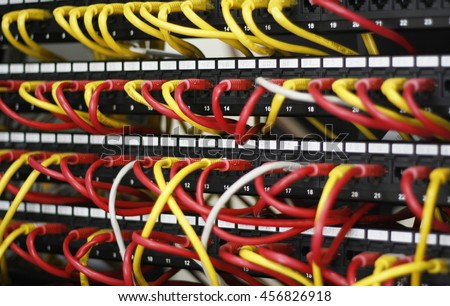 Network panel, switch and cable in data center, ethernet cables, server rack. Security, protection, firewall. network cables installed in the rack. Network Server. UTP Cat5e Cable with patch panel. - stock photo