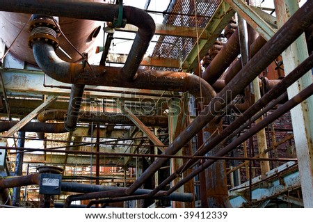 Network piping in abandoned factory - stock photo