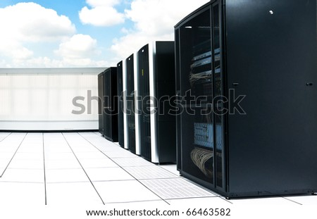 network server room and black servers with blue sky - stock photo