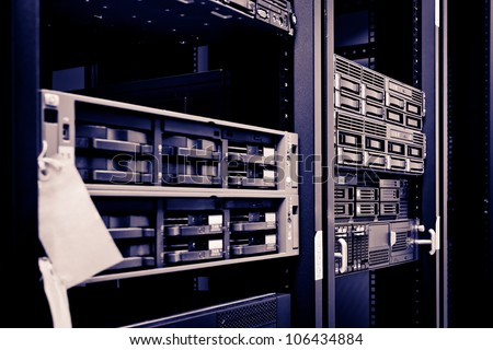 Network servers hdd in a data center. Swallow depth of field - stock photo