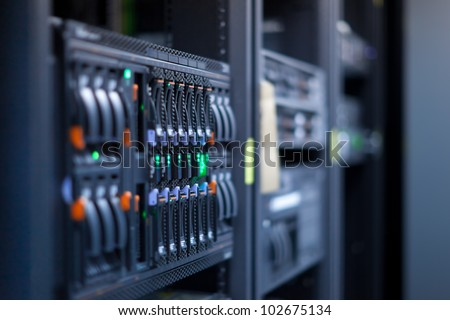 Network servers in a data center. Shallow depth of Field - stock photo