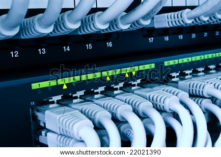 network switch and cables blue toned