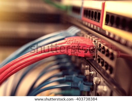 Network switch and ethernet cables,Data Center Concept. - stock photo