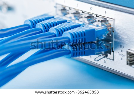 Network switch and ethernet cables, small home network - stock photo