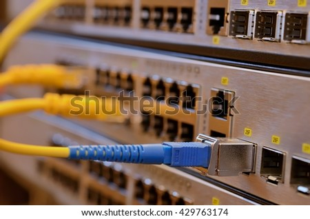 Network switch and fiber optic interface connection module - stock photo
