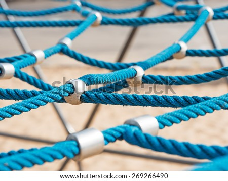 networked blue ropes on a climbing frame - stock photo