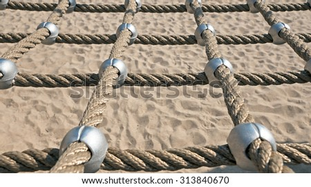 networked Ropes on climbing frame - stock photo