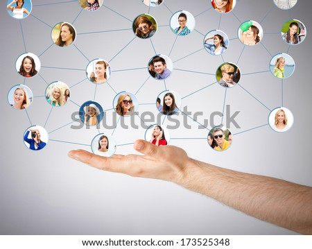 networking and communication concept - closeup of mans hand showing social network