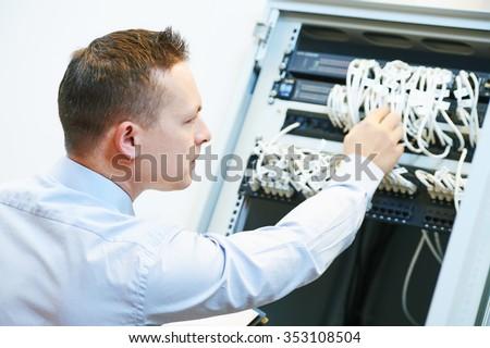 Networking service. network engineer administrator checking server hardware equipment of data center - stock photo