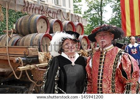 NEUBURG AN DER DONAU - JUNE 30: family in traditional German medieval costum at the festival on June 30, 2013 in Neuburg, Germany. This is annually festival in Neuburg in Bavaria, Germany - stock photo
