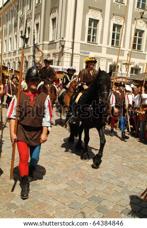 NEUBURG, GERMANY - JULY 3: unidentified spectators and actors at ancient city festival on July 03, 2005 in Neuburg on Danube, Bavaria, Germany