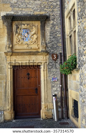 NEUCHATEL, SWITZERLAND - CIRCA JULY 2015 Wooden door of Neuchatel castle