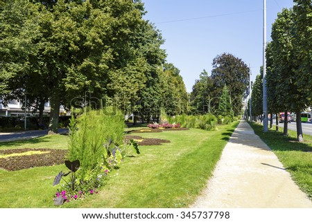 NEUCHATEL, SWITZERLAND - SEPTEMBER 09, 2015: City park along the street called Avenue du Premier-Mars in the city with a population of approx. 34000 mainly French-speaking residents - stock photo