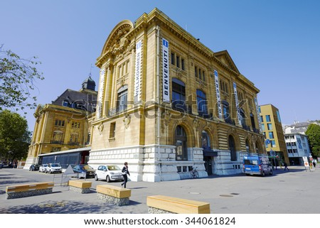 NEUCHATEL, SWITZERLAND - SEPTEMBER 09, 2015: Massive building, the seat of Post Office and the Tourist Information Office, the building is also well known as a Hotel des Postes - stock photo