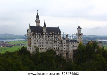 Neuschwanstein Castle, Germany August 2014. A beautiful castle set on top a mountain overlooking the German countryside