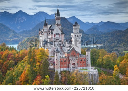 Neuschwanstein Castle, Germany. Image of the Neuschwanstein Castle surrounded with autumn colours during sunset. - stock photo