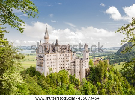 Neuschwanstein Castle is a nineteenth-century Romanesque Revival palace on a rugged hill above the village of Hohenschwangau near Fussen in southwest Bavaria, Germany. - stock photo