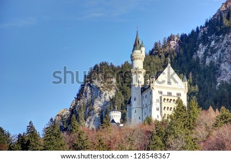 Neuschwanstein Castle. Neuschwanstein Castle is a 19th-century Romanesque Revival palace on a rugged hill above the village of Hohenschwangau near Fuessen (Füssen) in Bavaria, Germany.