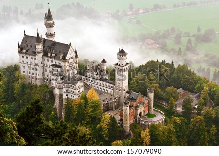 Neuschwanstein Castle shrouded in mist in the Bavarian Alps of Germany. - stock photo