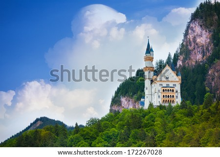 Neuschwanstein castle view in the mountains and castles - stock photo