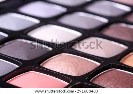 Neutral eyeshadows palette, closeup - stock photo