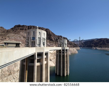 Nevada-side penstock towers of the Hoover Dam with Lake Mead below. - stock photo
