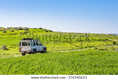 NEVE SHALOM, ISRAEL - JANUARY 31: SUV Land Rover Defender, rides on the country road among meadows in Neve Shalom, Israel on January 31, 2015