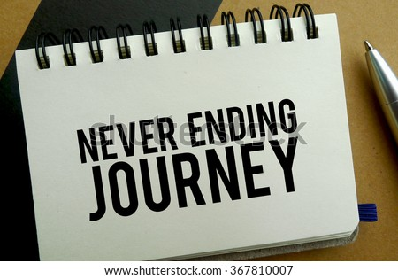 Never ending journey memo written on a notebook with pen