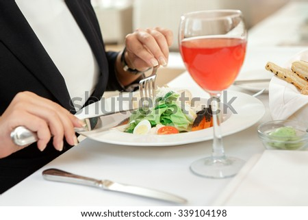 Never forget to restore your energy. Cropped shot of a business woman having salad for lunch  - stock photo