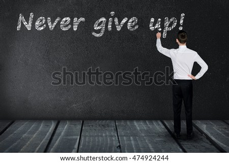 Never give up text write on black board