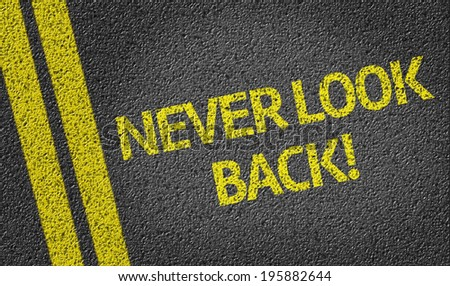 Never Look Back written on the road - stock photo