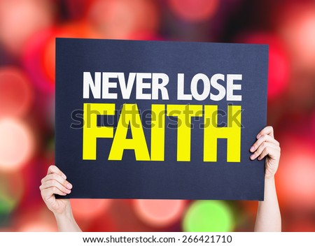 Never Lose Faith card with bokeh background - stock photo