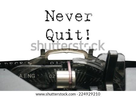 Never Quit on typewriter - stock photo