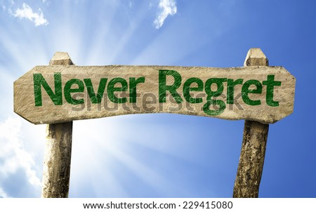 Never Regret sign on a summer day - stock photo