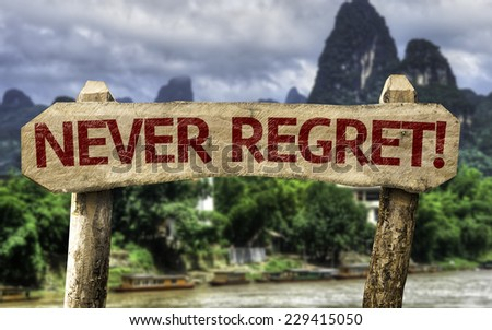 Never Regret sign with a forest background - stock photo