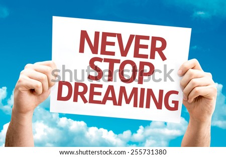 Never Stop Dreaming card with sky background - stock photo